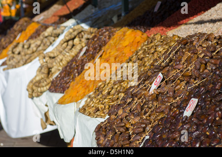 Dates and dried fruit for sale in the Djemaa el-Fna square, Marrakech, Morocco - Stock Photo