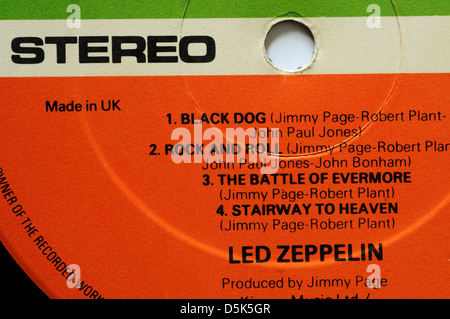 Led Zeppelin 4 record label with classic tracks Rock and Roll and Stairway to Heaven - Stock Photo
