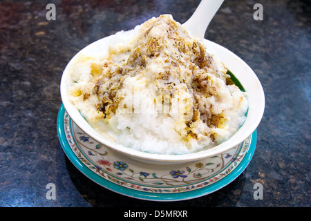 Cendol Shaved Ice Dessert with Gula Melaka Sugar Syrup and Coconut Milk Closeup - Stock Photo