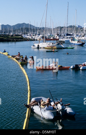 the boating community of marin county watch rock group entertainment at the sausalito art festival on Richardson - Stock Photo