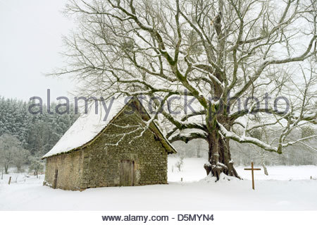 Small chapel at Le Mas Saint-Jean on a snowy winter day, Saint-Sulpice-le-Dunois, La Creuse, Limousin, France - Stock Photo