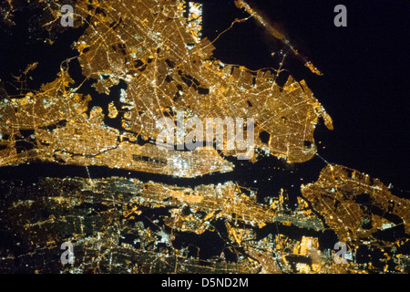 The New YorK metropolitan area at night is seen from the Expedition 35 orbiting the Earth n March 23, 2013 (NASA) - Stock Photo