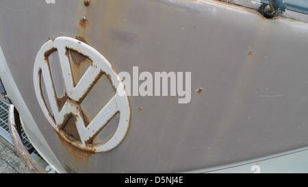 A VW badge on an old Volkswagen van. - Stock Photo