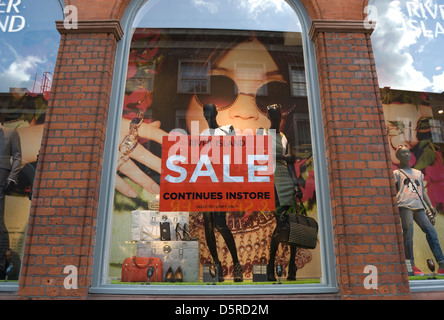 shop window poster advertising  a sale at a branch of the nationwide retailer river island, richmond, surrey, england - Stock Photo