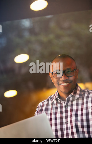 Man carrying papers indoors - Stock Photo