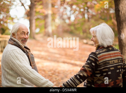 Older couple walking in park - Stock Photo