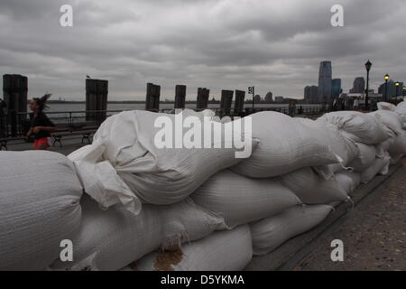 Sand sacks are piled up at the southern end of Manhattan where the Hudson and East River meet in New York, USA, - Stock Photo