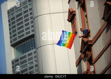 A man waves with a rainbow flag, while than 20 000 people demonstrate against Europe's austerity plans and banks - Stock Photo