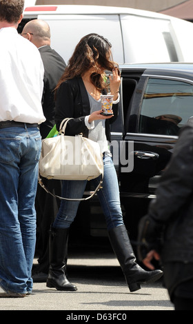 Mila Kunis keeps her face covered with her hair as she leaves a studio in Hollywood Los Angeles, California - 07.04.11 - Stock Photo