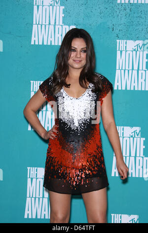 US actress Mila Kunis poses in the press room of the 2012 MTV Movie Awards at Gibson Amphitheatre in Universal City, - Stock Photo