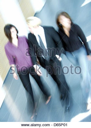 business,3 persons,dynamic - Stock Photo