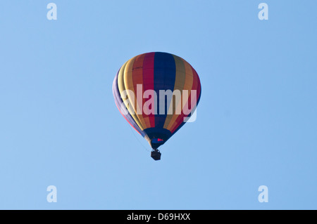 Brightly Coloured Hot Air Balloon Against A Blue Sky - Stock Photo
