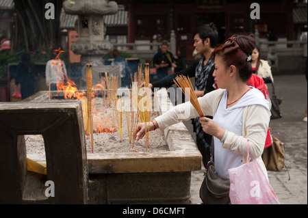 Guangzhou, China, Feuerstaette for incense sticks in the yard of Filial Piety Temple - Stock Photo