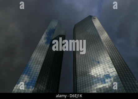 FILE - An archive picture dated 17 December 2011 shows dark clouds gathering over the twin towers of the Deutsche - Stock Photo