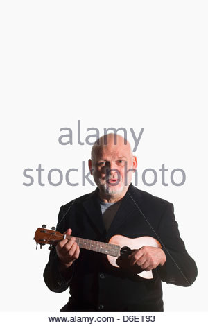Senior Man playing Ukulele Munich Germany - Stock Photo
