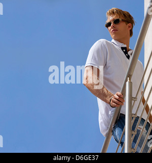 Portrait of fashionable guy in relaxed attitude - Stock Photo