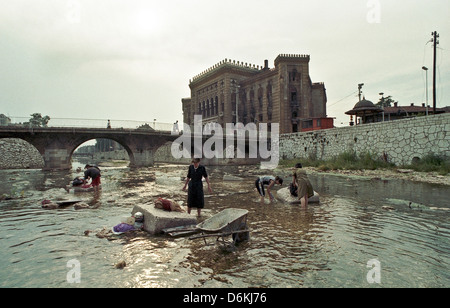 Citizens washing their clothing in the Miljacka, Sarajevo, Bosnia and Herzegovina - Stock Photo