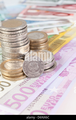Berlin, Germany, Euro notes, and a Euromuenzen Singapore dollar coin - Stock Photo