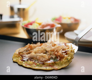 Japanese-style Okonomiyaki pancake - Stock Photo
