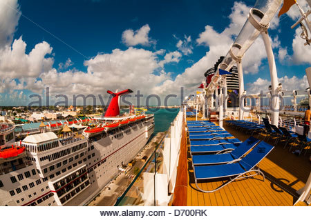 Carnival Fascination (on left) and Disney Dream (on right) cruise ships docked in Nassau, The Bahamas. - Stock Photo