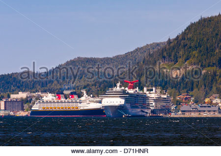 Cruise ships Disney Dream, Carnival Spririt and Holland America 'Amsterdam' docked in Ketchikan, Southeast Alaska - Stock Photo