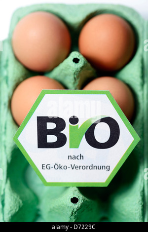 Chicken eggs with bio-seal, symbolic photo wrong declared biology eggs - Stock Photo
