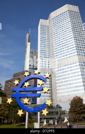 Frankfurt, Germany, the Euro sculpture in front of the Tower of the ECB euro - Stock Photo