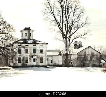 abandoned old farmhouse and barn in winter - Stock Photo