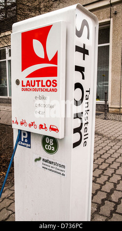 A public electric car charging station in Berlin. - Stock Photo