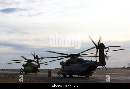 Two United States Marine Corps CH-53E Super Stallion helicopters refuel before mission Camp Bastion Helmand Province - Stock Photo