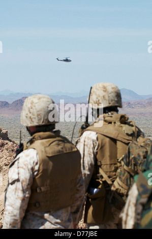 US Marines on ground directing Marine Corps AH-1W SuperCobra during live fire close air support training Chocolate - Stock Photo