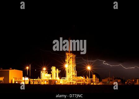 Night view petroleum processing facility lightning Weatherford Oklahoma USA - Stock Photo