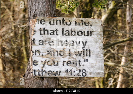 Broken religious sign typical of many erected in rural Protestant areas of Northern Ireland. - Stock Photo