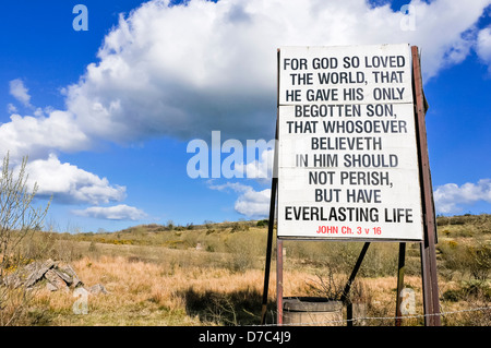 Religious sign typical of many erected in rural Protestant areas of Northern Ireland. 'For God so loved the world...' - Stock Photo