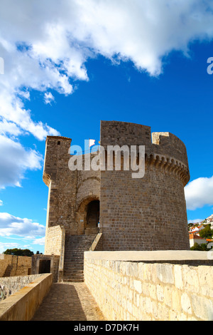 Minceta Tower of defense wall of Old town in Dubrovnik, Croatia with cloudy blue sky - Stock Photo