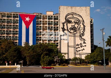 Ministry of Interior building with Che Guevara mural and Cuban flag on Revolution Square 'Plaza de la Revolucion' - Stock Photo