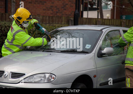 Formby, Merseyside, UK  8th May, 2013. Cutting the windscreen with hydraulic ram. A Road Traffic Accident Rescue - Stock Photo