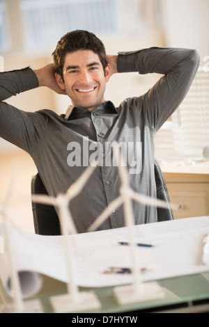Architect working in firm dealing with wind power - Stock Photo