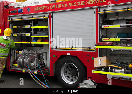 Formby, Merseyside, UK  8th May, 2013. Fire engine equipment, red fire truck, emergency rescue vehicle, engine, - Stock Photo