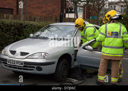 Formby, Merseyside, UK  8th May, 2013. Cutting through car door hinges. A Rescue Demonstration during National Road - Stock Photo