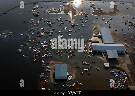 Aerial view of massive flooding and destruction scattering cars in the aftermath of Hurricane Katrina September - Stock Photo