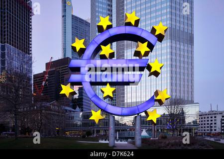 Frankfurt am Main, Germany, illuminated euro sculpture in front of ECB - Stock Photo