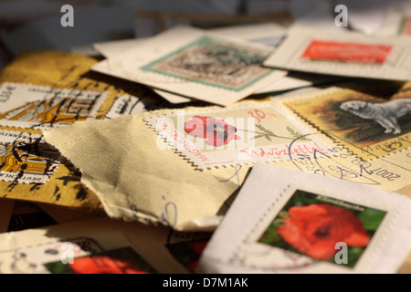 Postage stamps from around the world, varied and colorful - Stock Photo