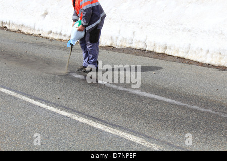 Road maintenance cleaning a Trace of oil in winter - Stock Photo