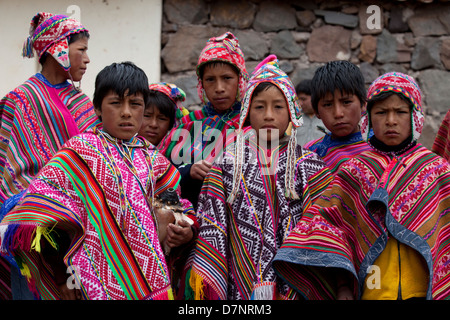 Portrait of young Quechua boys at Pisac in traditional colorful dress - Stock Photo