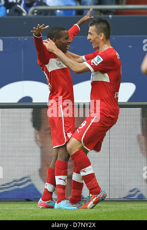 Stuttgart's Vedad Ibisevic celebrates his 1-0 goal with Ibrahima Traore (C) during the German Bundesliga match between - Stock Photo