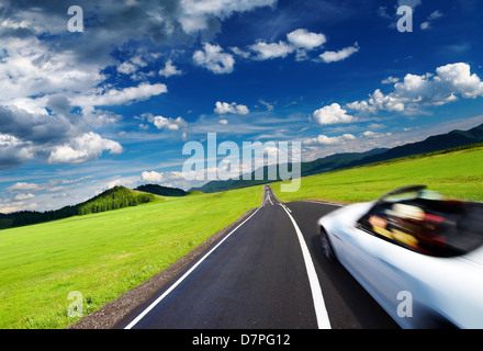 Sports car in motion blur on empty road - Stock Photo