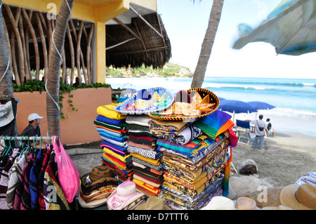 Colorful sombreros and serapes for sale at a beach in Sayulita, Mexico. - Stock Photo