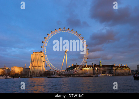 London Eye, River Thames, and City Hall from Victoria Embankment at sunset, London, England, United Kingdom - Stock Photo
