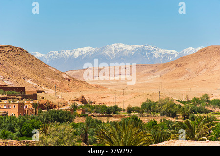 Snow capped High Atlas Mountains from Kasbah Ait Ben Haddou, near Ouarzazate, Morocco, North Africa - Stock Photo